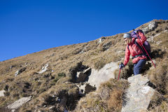 The girl coming down the mountain. Royalty Free Stock Photo