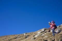 The girl coming down the mountain. Stock Photos