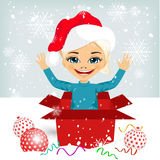 Girl coming out of inside christmas gift box Royalty Free Stock Images
