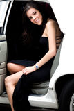 Girl coming out a limousine Stock Image