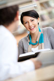 Girl communicates with handsome man at the library Royalty Free Stock Photo