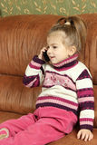 The girl communicates by the mobile phone Royalty Free Stock Photography