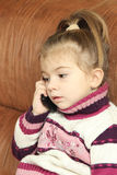The girl communicates by the mobile phone Stock Image