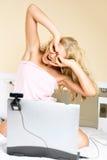 Girl communicating using a web camera Stock Images
