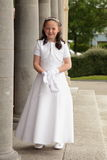 Girl in communion dress. Stock Images