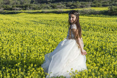 Girl with communion dress Stock Photography