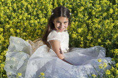 Girl with communion dress Stock Image