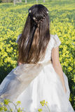 Girl with communion dress Stock Photos
