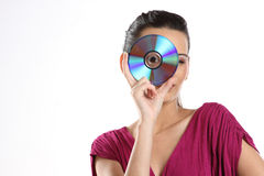 Girl with a compact disk Royalty Free Stock Photography