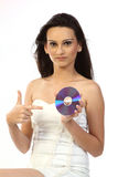 girl with a compact disk in hands. Stock Image