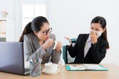 Girl company employee having disease problem Stock Images