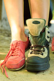 Girl compare footwear. Royalty Free Stock Photo
