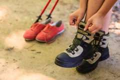 Girl compare footwear. Royalty Free Stock Photos