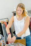 Girl comparing two bracelets on wrists. Girl comparing two bracelets on her wrists Stock Photography