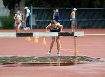 Girl compete in the 3.000 Meter Steeplechase Stock Image