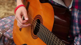 Girl composes music with a guitar stock video footage