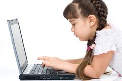 Girl with computer. Photo of a girl with laptop, isolated on whita Royalty Free Stock Images