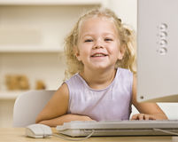 Girl on Computer Royalty Free Stock Photography