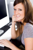 Girl on computer Stock Images