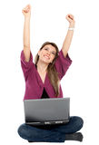 Girl with a computer Stock Images