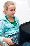 Girl and computer Royalty Free Stock Photos