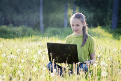 Girl with computer  Stock Photography