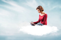 Girl with a computer. Photo of the girl with a computer on a cloud royalty free stock images