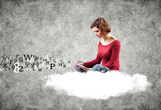 Girl with a computer. Photo of the girl with a computer on a cloud stock photography