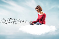 Girl with a computer. Photo of the girl with a computer on a cloud royalty free stock photo