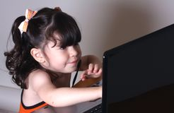 Girl and computer Royalty Free Stock Photo