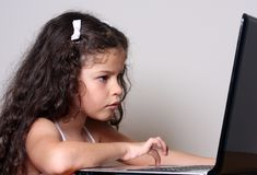 Girl and computer Royalty Free Stock Images