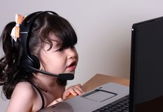 Girl and computer Royalty Free Stock Image