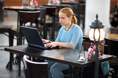 Girl with computer in cafe Stock Photo