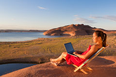 Girl with Computer at Lake Powell Sunrise Royalty Free Stock Image