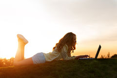 Girl with computer in nature. Stock Images