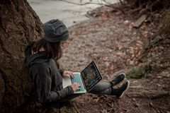 People and technology. Girl with a computer in nature Stock Images