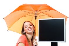Girl an computer under umbrella Stock Images