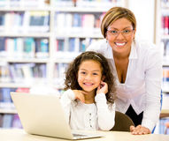 Girl with a computers teacher Royalty Free Stock Photography