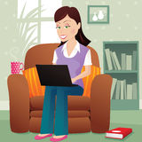 Girl computing on lap Stock Images