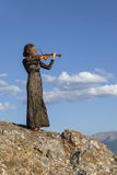 Girl in concert dress, playing the violin Royalty Free Stock Photos