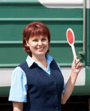 Girl-conductor smiles Stock Image