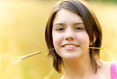 Girl with cone in teeth Royalty Free Stock Photography