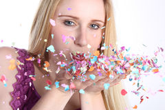 Girl with confetti Stock Images