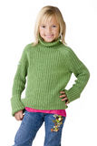 Girl with confidence. Blonde girl 7 years old smiling to camera in green sweater on white background Royalty Free Stock Photos