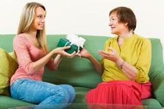 Girl congratulate mother Stock Photo