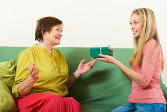 Girl congratulate mother Stock Images