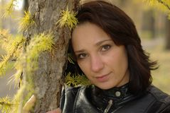 Girl in a coniferous forest Stock Photo