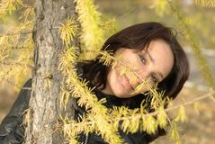 Girl in a coniferous forest Royalty Free Stock Photo