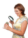 Girl considers a cactus through a magnifier Royalty Free Stock Images