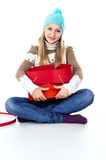 The girl considers gifts in winter clothes Royalty Free Stock Photos